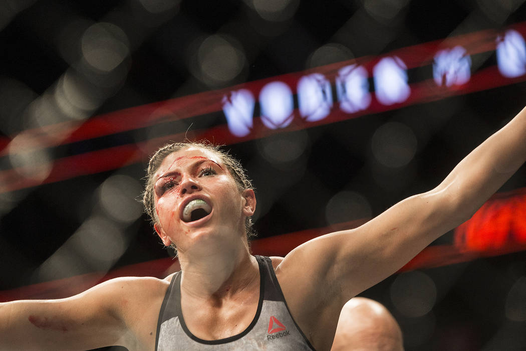 Ashley Yoder lobby's the crowd for support after her strawweight matchup with Mackenzie Dern at UFC 222 at T-Mobile Arena on Saturday, March 3, 2018, in Las Vegas. Dern defeated Yoder by split dec ...