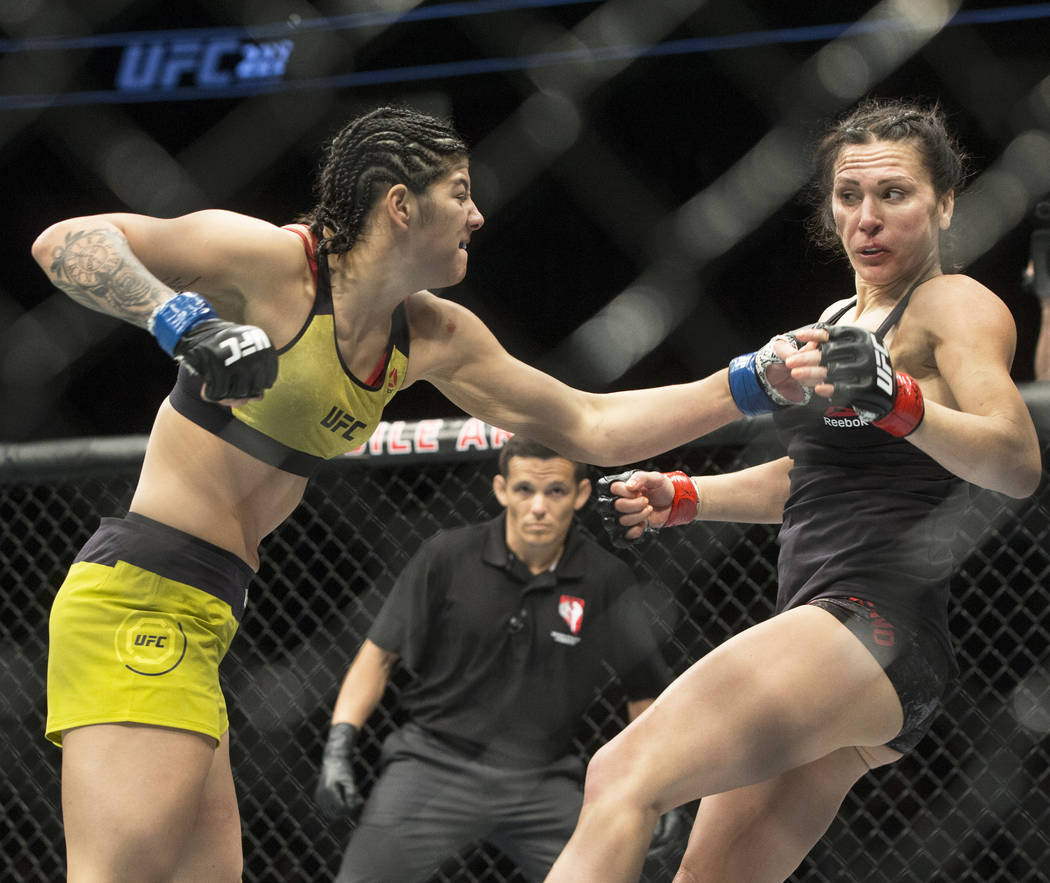 Ketlen Viera, left, connects with a left hook against Cat Zingano during their bantamweight matchup at UFC 222 at T-Mobile Arena on Saturday, March 3, 2018, in Las Vegas. Viera beat Zingano by spl ...