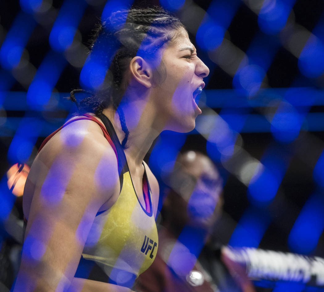 Ketlen Viera screams in the direction of Cat Zingano during their bantamweight matchup at UFC 222 at T-Mobile Arena on Saturday, March 3, 2018, in Las Vegas. Viera beat Zingano by split decision.  ...