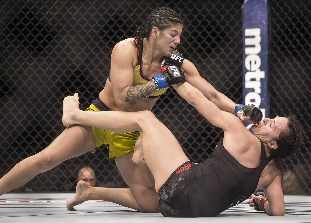 Ketlen Viera, left, connects with a jab against Cat Zingano during their bantamweight matchup at UFC 222 at T-Mobile Arena on Saturday, March 3, 2018, in Las Vegas. Viera beat Zingano by split dec ...