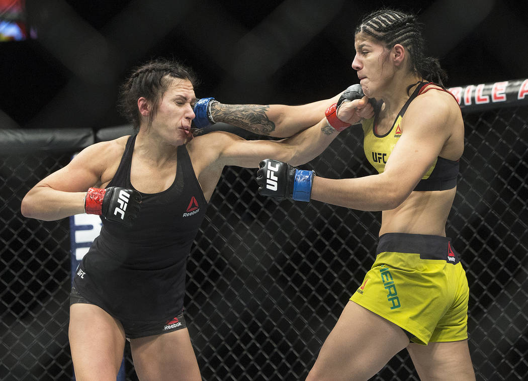 Ketlen Viera, right, connects with a right hook against   Cat Zingano during their bantamweight matchup at UFC 222 at T-Mobile Arena on Saturday, March 3, 2018, in Las Vegas. Viera beat Zingano by ...
