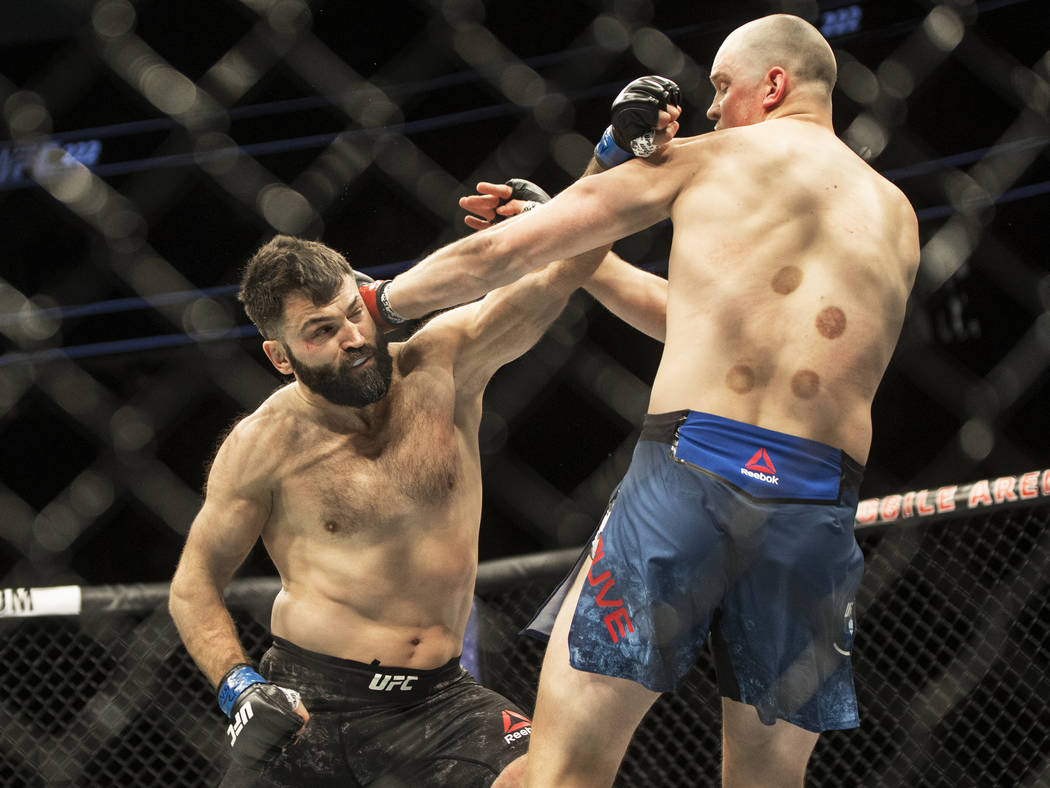 Andrei Arlovski, left, connects with a left hook against Stefan Struve during their heavyweight matchup at UFC 222 at T-Mobile Arena on Saturday, March 3, 2018, in Las Vegas. Arlovski beat Struve  ...