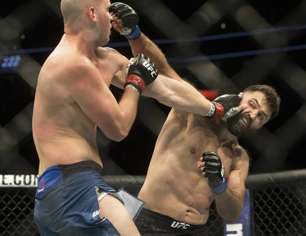 Andrei Arlovski, right, connects with a right hook against Stefan Struve during their heavyweight matchup at UFC 222 at T-Mobile Arena on Saturday, March 3, 2018, in Las Vegas. Arlovski beat Struv ...