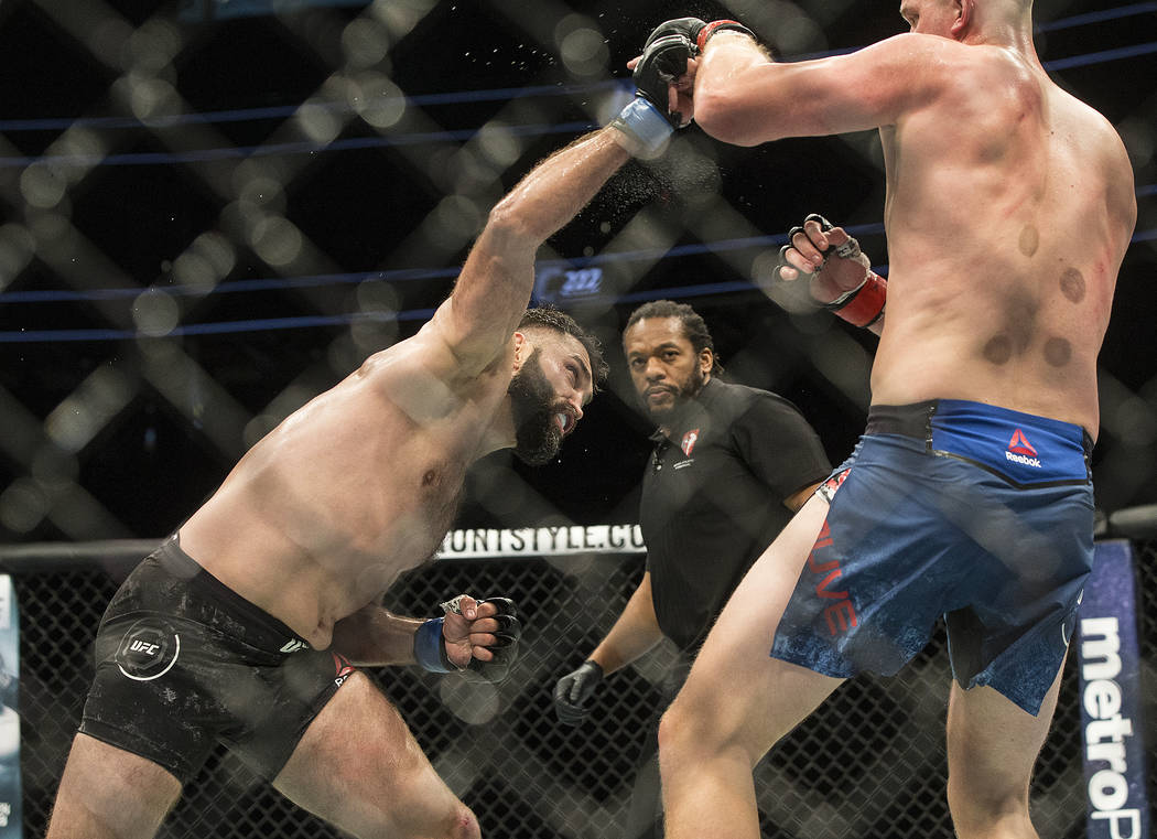 Andrei Arlovski, left, connects with a right hook against Stefan Struve during their heavyweight matchup at UFC 222 at T-Mobile Arena on Saturday, March 3, 2018, in Las Vegas. Arlovski beat Struve ...