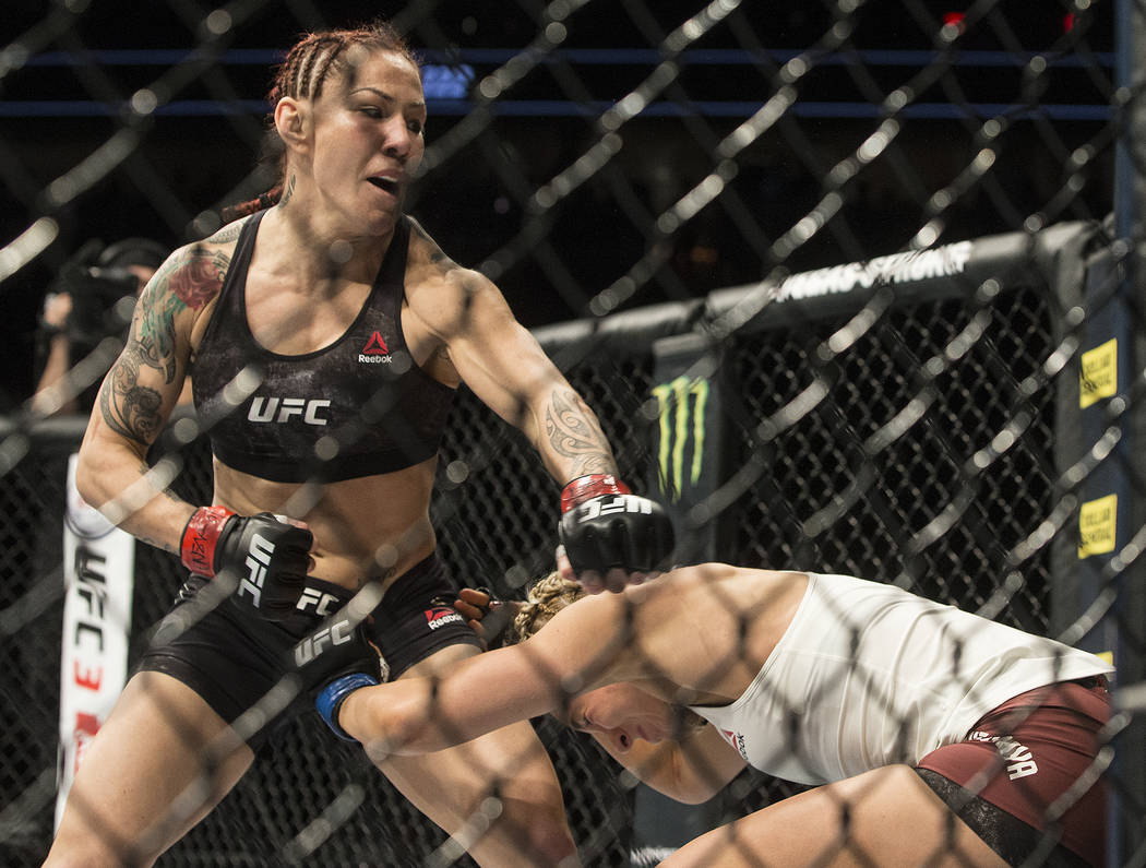 Cris Cyborg, left, connects with a left hook against Yana Kunitskaya during their featherweight championship matchup at UFC 222 at T-Mobile Arena on Saturday, March 3, 2018, in Las Vegas. Cyborg w ...