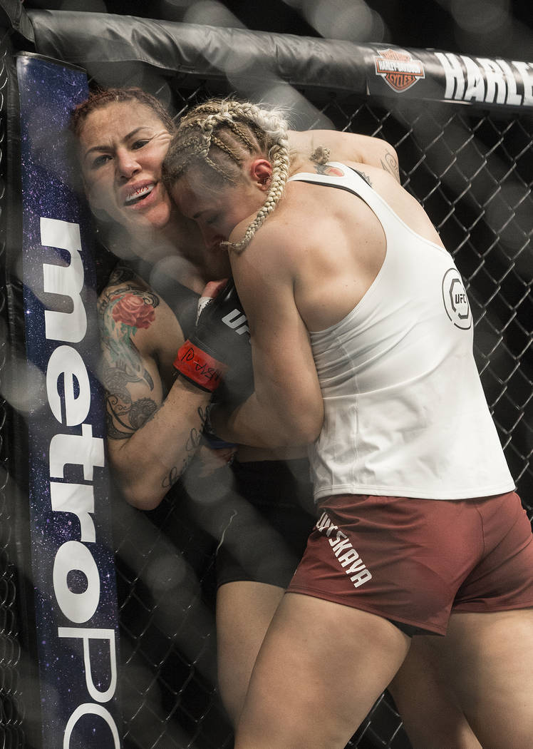 Cris Cyborg, left, battles for position with Yana Kunitskaya during their featherweight championship matchup at UFC 222 at T-Mobile Arena on Saturday, March 3, 2018, in Las Vegas. Cyborg won via f ...