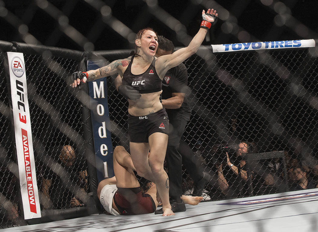 Cris Cyborg celebrates after defending her featherweight title against Yana Kunitskaya via first round stoppage at UFC 222 at T-Mobile Arena on Saturday, March 3, 2018, in Las Vegas. Benjamin Hage ...