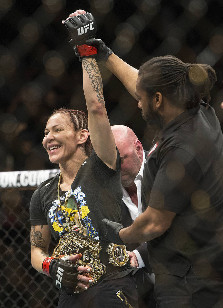 Cris Cyborg, left, celebrates after defending her featherweight title against Yana Kunitskaya via first round stoppage at UFC 222 at T-Mobile Arena on Saturday, March 3, 2018, in Las Vegas. Benjam ...