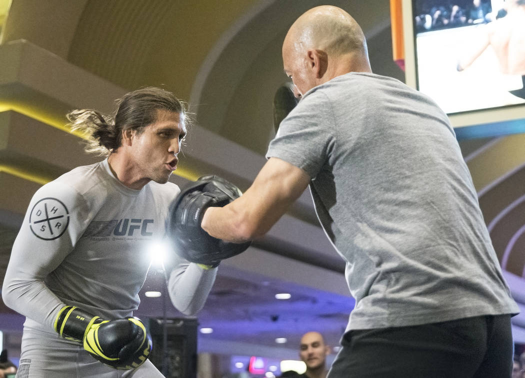 Brian Ortega, left, the number three UFC featherweight contender, warms up during open workouts leading up to Saturday's UFC 222 on Thursday, March 1, 2018, at the MGM Grand hotel-casino, in Las V ...