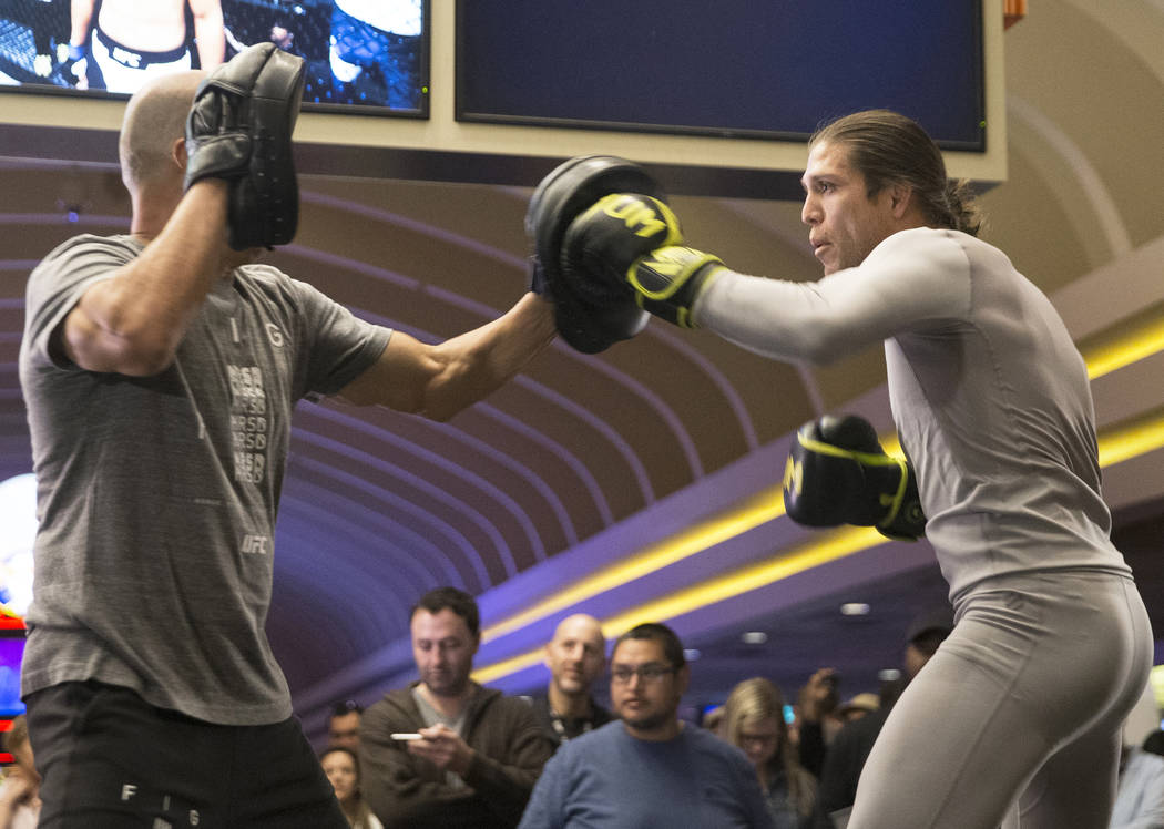 Brian Ortega, right, the number three UFC featherweight contender, throws a jab during open workouts leading up to Saturday's UFC 222 on Thursday, March 1, 2018, at the MGM Grand hotel-casino, in  ...
