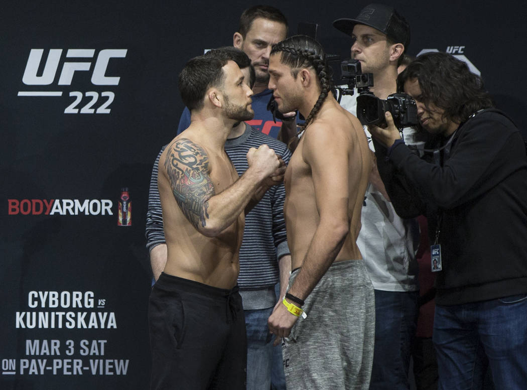 Featherweight's Frankie Edgar, left, and Brian Ortega go head to head during weighs-ins for UFC 222 at the Park Theater on Friday, March 2, 2018, at the Monte Carlo hotel-casino, in Las Vegas. Ben ...