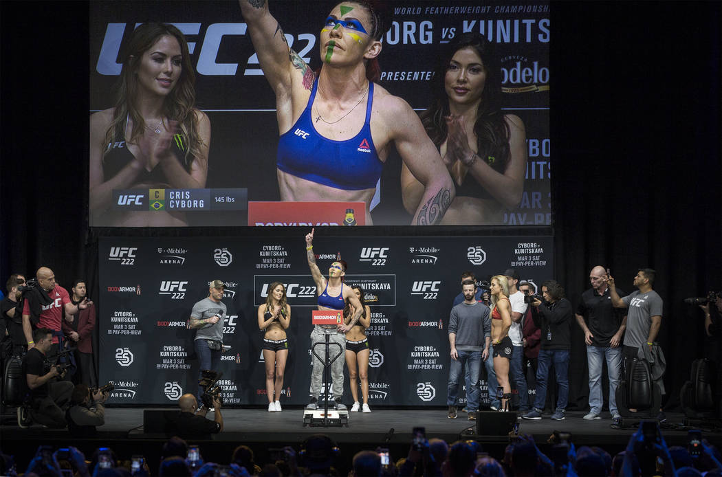 Cris Cyborg, UFC womenճ featherweight champion, salutes her fans during weighs-ins for UFC 222 at the Park Theater on Friday, March 2, 2018, at the Monte Carlo hotel-casino, in Las Vegas. Be ...