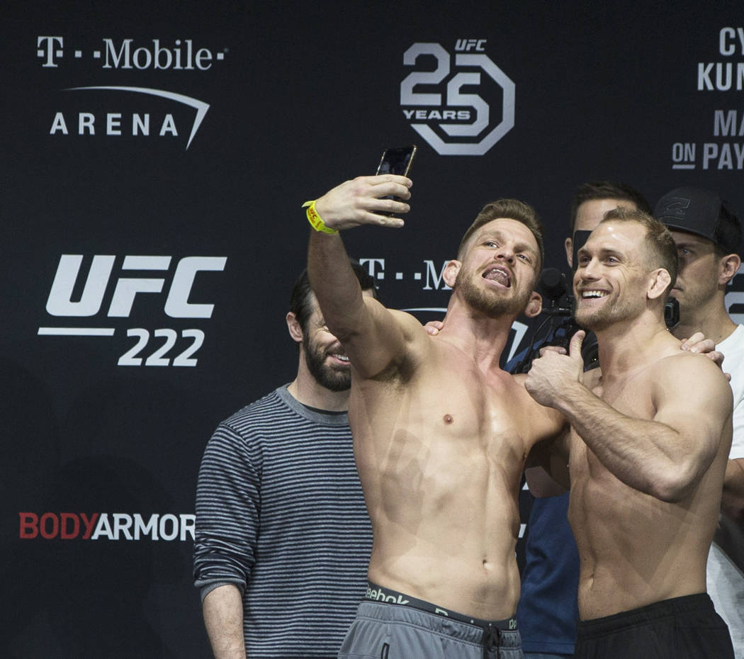 Welterweight's Mike Pyle, left, takes a selfie with Zak Ottow during weighs-ins for UFC 222 at the Park Theater on Friday, March 2, 2018, at the Monte Carlo hotel-casino, in Las Vegas. Benjamin Ha ...