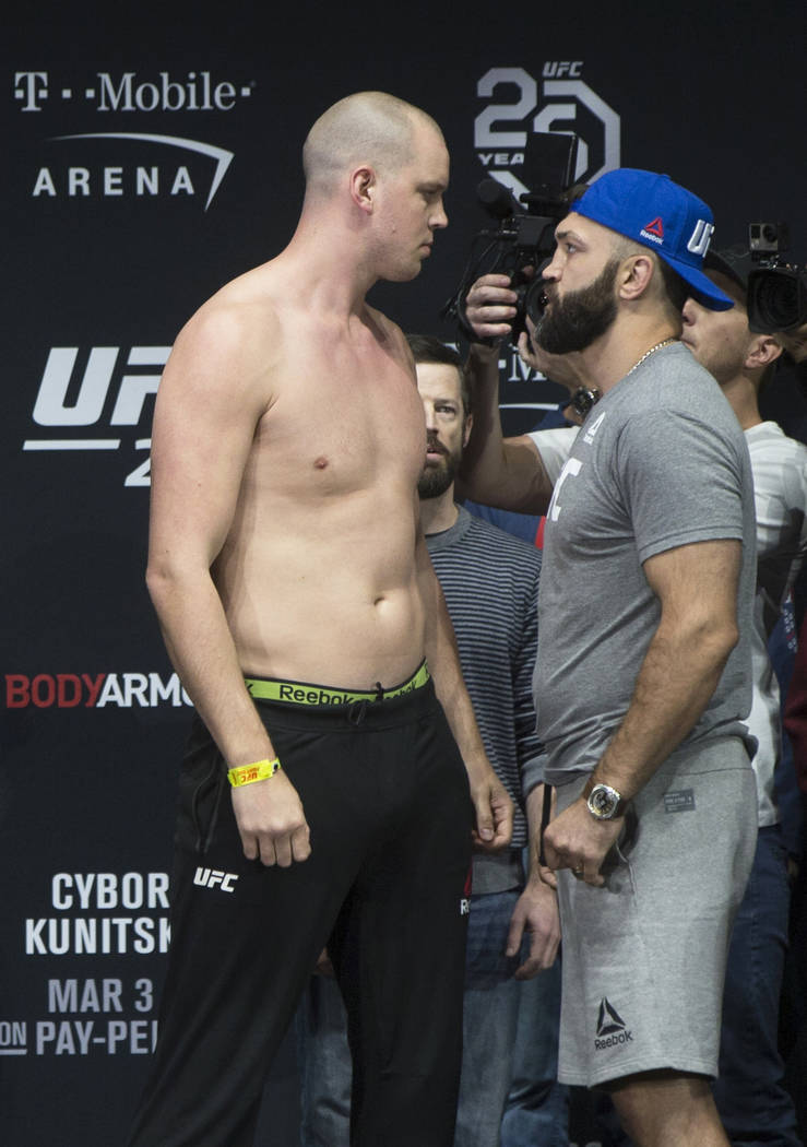 Heavyweight's Stefan Struve, left, and Andrei Arlovski face off during weighs-ins for UFC 222 at the Park Theater on Friday, March 2, 2018, at the Monte Carlo hotel-casino, in Las Vegas. Benjamin  ...