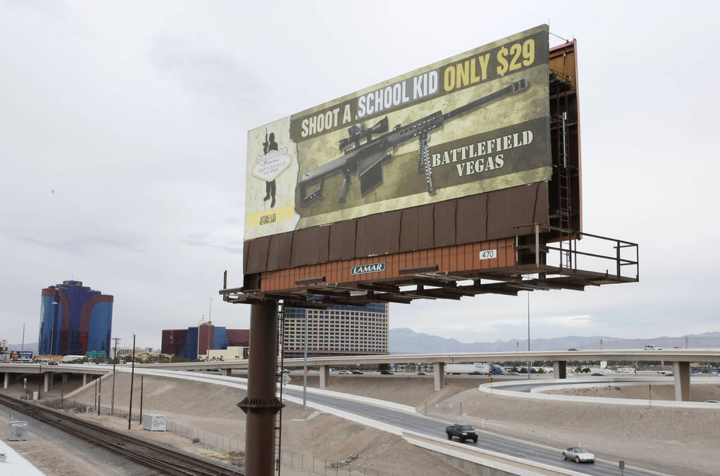 A vandalized billboard near Interstate 15 and Spring Mountain Road in Las Vegas is seen Thursday, March 1, 2018. The billboard is an advertisement for Battlefield Vegas, a Las Vegas shooting range ...