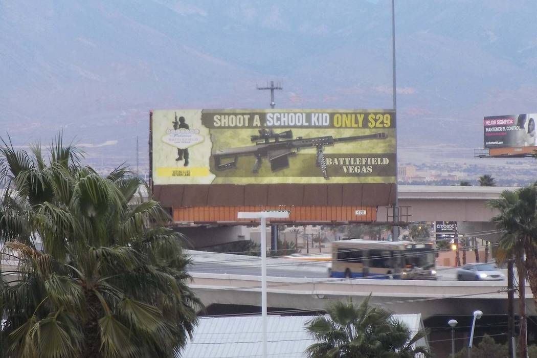 A billboard near Interstate 15 and Spring Mountain Road in Las Vegas was changed overnight by vandals, Thursday, March 1, 2018. The billboard is an advertisement for Battlefield Vegas, a Las Vegas ...
