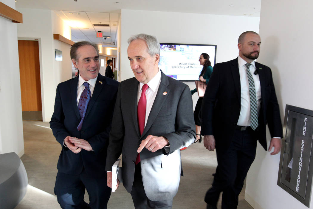 Secretary of Veteran's Affairs David Shulkin, left, gets a tour of the Lou Ruvo Center for Brain Health, Cleveland Clinic from founder Larry Ruvo Friday, March 9, 2018. Shulkin visited the Las Veg ...