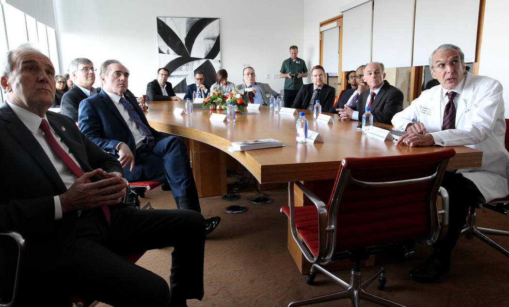 Secretary of Veteran's Affairs David Shulkin, second from left, watches a presentation about the Lou Ruvo Center for Brain Health, Cleveland Clinic with founder Larry Ruvo, left, and Director Dr.  ...