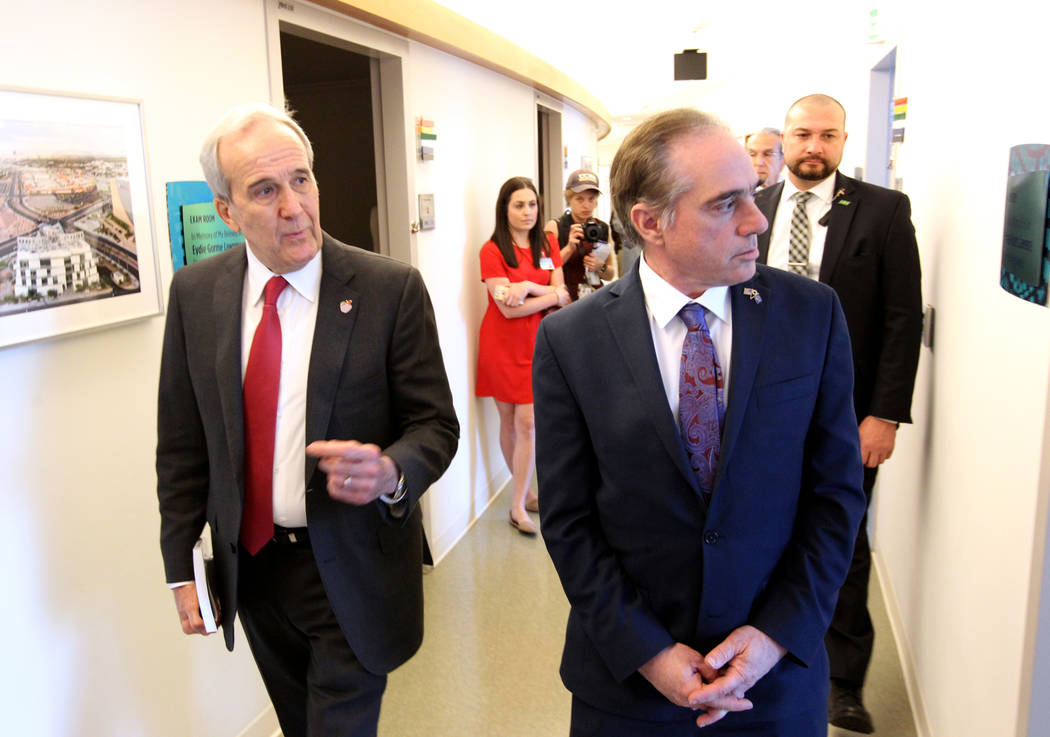 Secretary of Veteran's Affairs David Shulkin, right, gets a tour of the Lou Ruvo Center for Brain Health, Cleveland Clinic from founder Larry Ruvo Friday, March 9, 2018. Shulkin visited the Las Ve ...