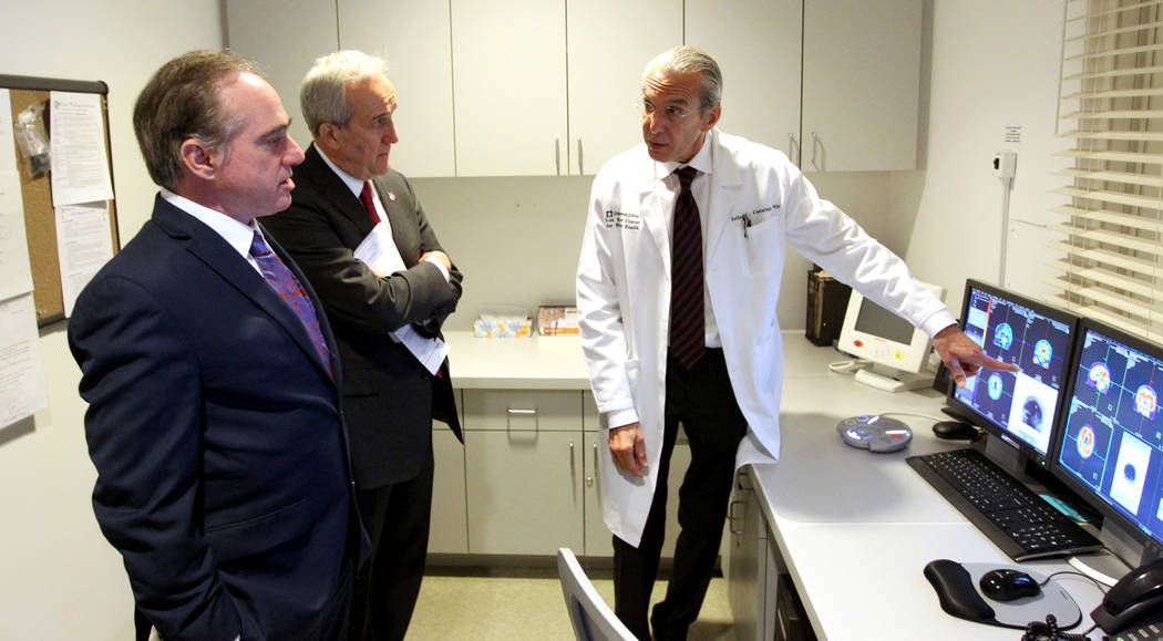 Secretary of Veteran's Affairs David Shulkin, left, gets a tour of the Lou Ruvo Center for Brain Health, Cleveland Clinic in Las Vegas from founder Larry Ruvo, center, and Director Dr. Jeffrey Cum ...