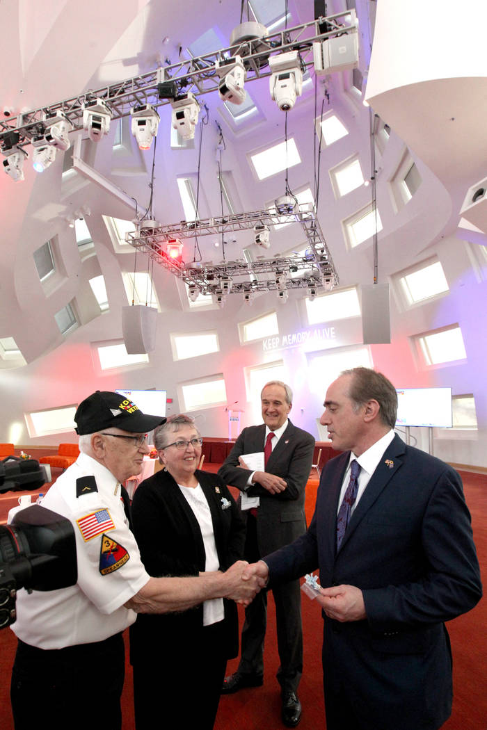 Secretary of Veteran's Affairs David Shulkin, right, meets husband and wife veterans Vincent and Judith Ariola at the Lou Ruvo Center for Brain Health, Cleveland Clinic as founder Larry Ruvo looks ...