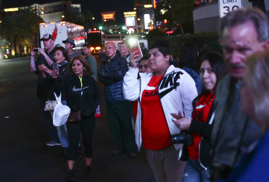 Fans watch as haulers parade down the Las Vegas Strip near Harmon Road ahead of the NASCAR Monster Energy Cup in Las Vegas on Thursday, March 1, 2018. Chase Stevens Las Vegas Review-Journal @csste ...