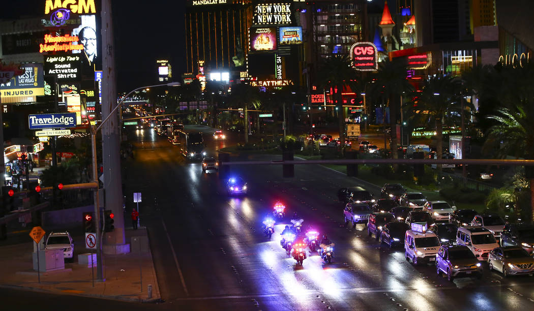 Las Vegas police officers lead the way as haulers parade down the Las Vegas Strip near Harmon Road ahead of the NASCAR Monster Energy Cup in Las Vegas on Thursday, March 1, 2018. Chase Stevens Las ...