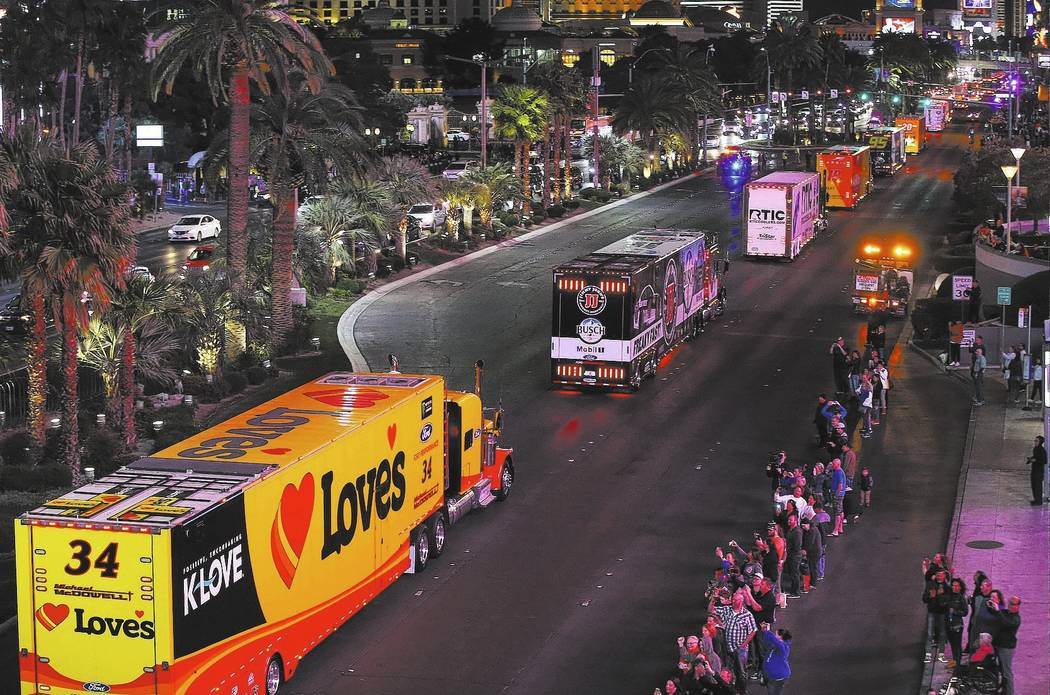 The haulers of Michael McDowell (34) and Kevin Harvick (4) parade down the Las Vegas Strip near Harmon Road ahead of the NASCAR Monster Energy Cup in Las Vegas on Thursday, March 1, 2018. Chase St ...