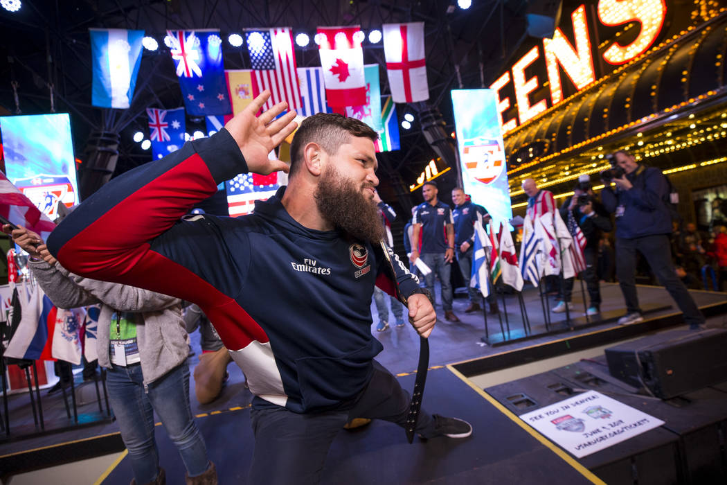 USA Rugby Sevens player Danny Barrett hypes the crowd as team USA is introduced on stage during the Parade of Nations at the Fremont Street Experience in downtown in Las Vegas on Thursday, March 1 ...