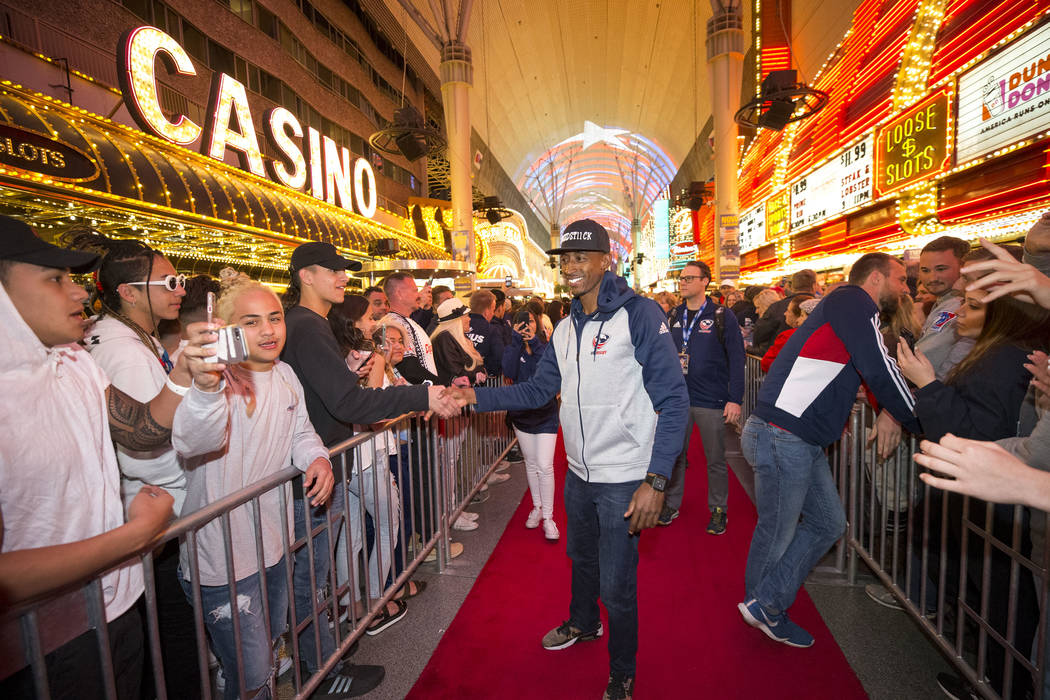 USA Rugby Sevens player Perry Baker is greeted by fans during the Parade of Nations at the Fremont Street Experience in downtown in Las Vegas on Thursday, March 1, 2018. Richard Brian Las Vegas Re ...