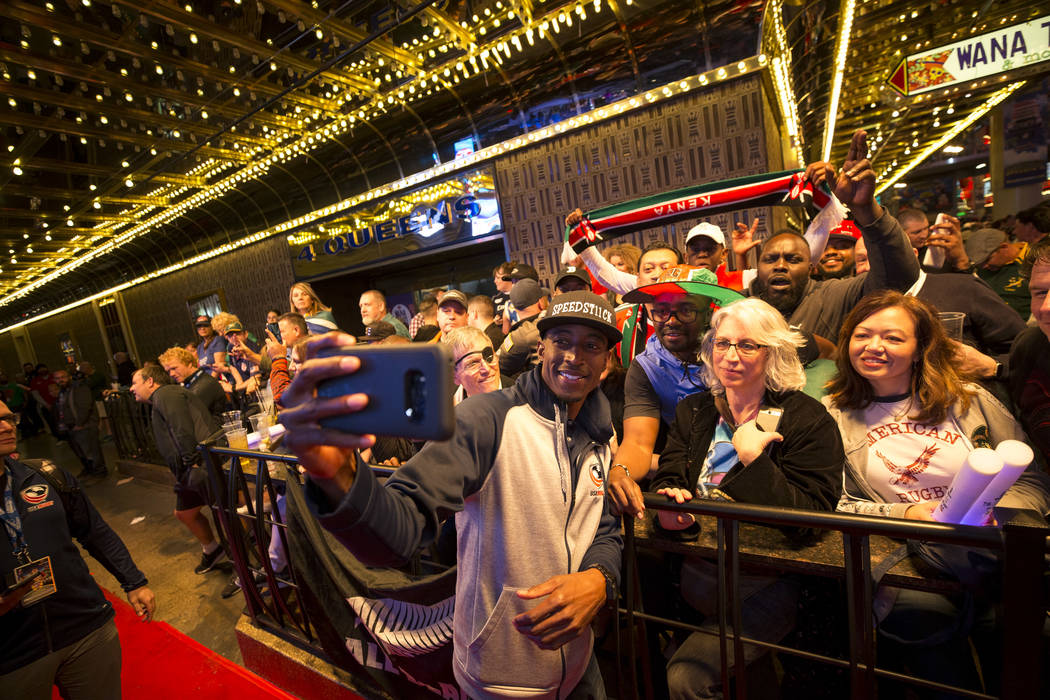 USA Rugby Sevens player Perry Baker snaps a selfie with fans during the Parade of Nations at the Fremont Street Experience in downtown in Las Vegas on Thursday, March 1, 2018. Richard Brian Las Ve ...