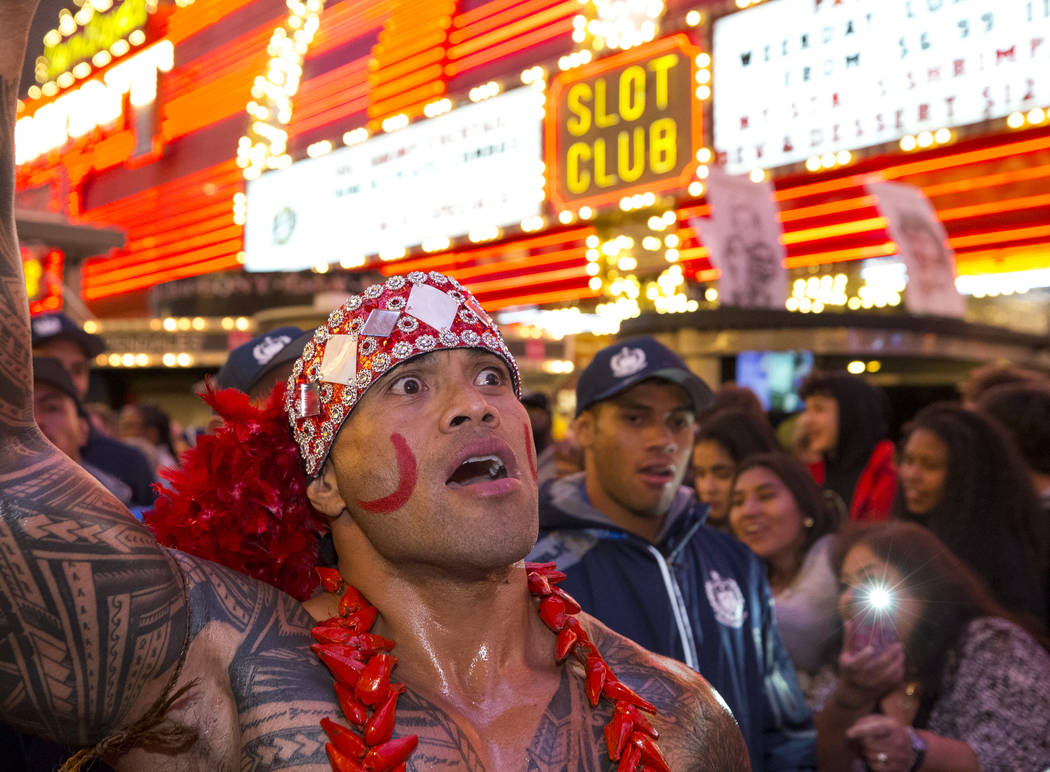 Hio Pelesasa marches with the Samoan Rugby team during the Parade of Nations at the Fremont Street Experience in downtown in Las Vegas on Thursday, March 1, 2018. Richard Brian Las Vegas Review-Jo ...