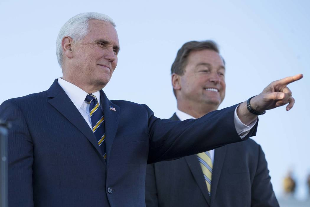 Vice President Mike Pence, left, will campaign for Nevada Sen. Dean Heller in April. Pence was in Las Vegas with Heller for a pair of Air Force events in January. (Richard Brian/Las Vegas Review-J ...