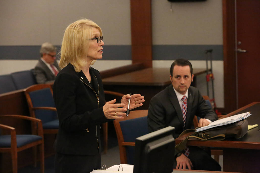 Samuel Warren, right, listens as Alice Denton attorney for Larry Bertsch, requests that Judge Gloria Sturman appoint Bertsch special administrator of the estate of Stephen Paddock on Thursday, Mar ...