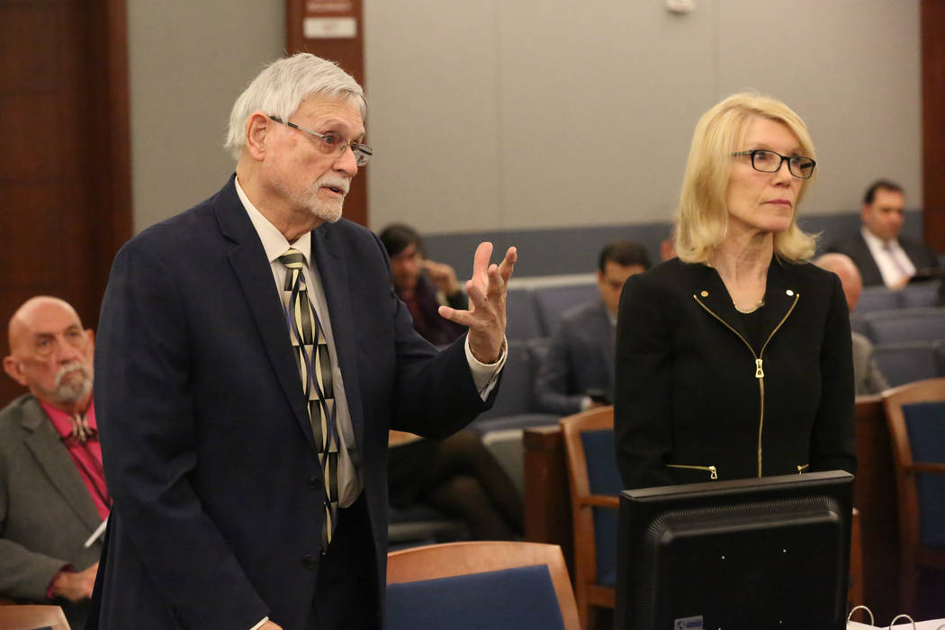 Larry Bertsch, left, stands with his attorney Alice Denton to address Judge Gloria Sturman on some of the the tasks he will execute as special administrator of the estate of Stephen Paddock on Thu ...