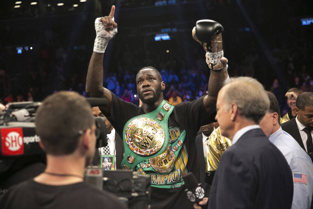 Deontay Wilder celebrates after knocking out Bermane Stiverne in the first round of the WBC heavyweight title boxing bout Saturday, Nov. 4, 2017, in New York. (AP Photo/Kevin Hagen)