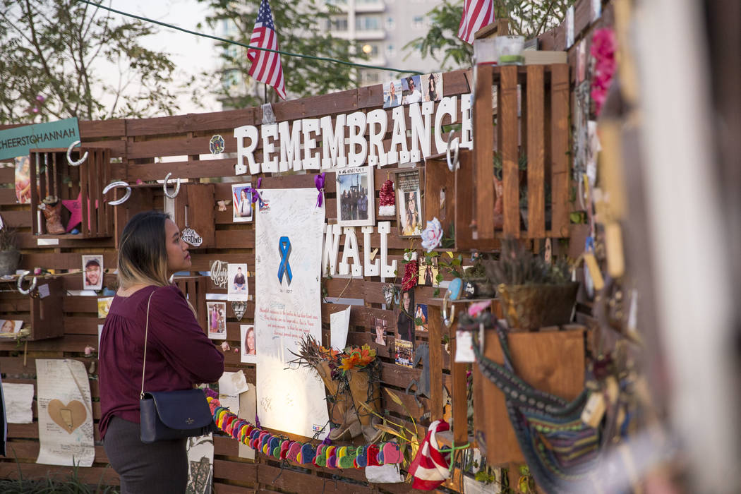 Joanne Viloria of Hawaii visit the remembrance wall at the Community Healing Garden in downtown Las Vegas, Thursday, Nov. 30, 2017. (Richard Brian/Las Vegas Review-Journal) @vegasphotograph