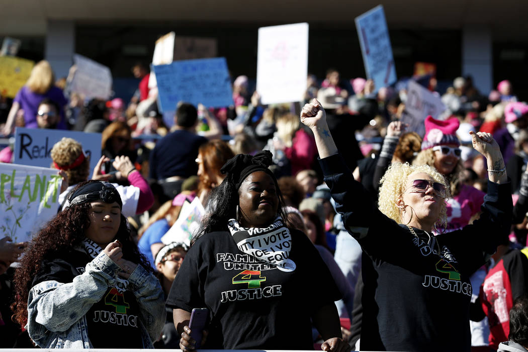 Attendees gather for the Power to the Polls event, hosted by the Women's March, at the Sam Boyd Stadium in Las Vegas, Sunday, Jan. 21, 2018. The event, which served as an advocacy tool to register ...