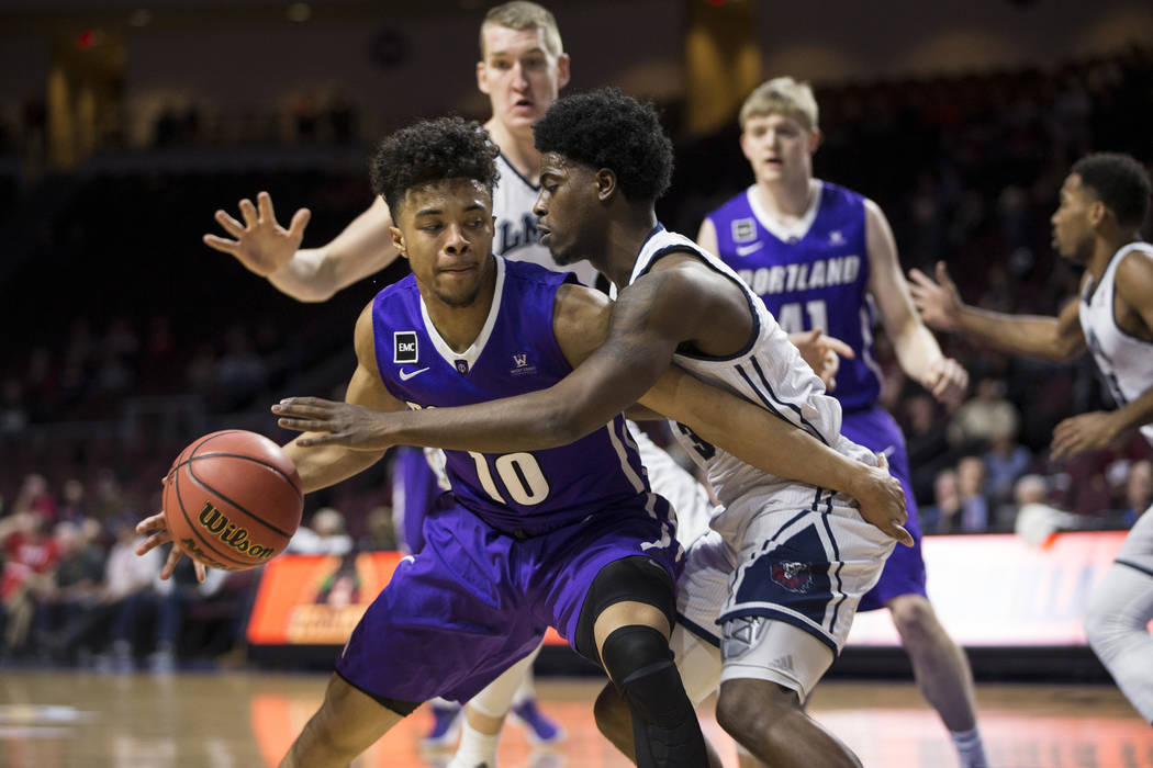 Portland Pilots guard Marcus Shaver Jr. (10) is pressured by Loyola Marymount Lions guard Cameron Allen (3)in the first half ofthe West Coast Conference Men's Basketball Tournament gam ...
