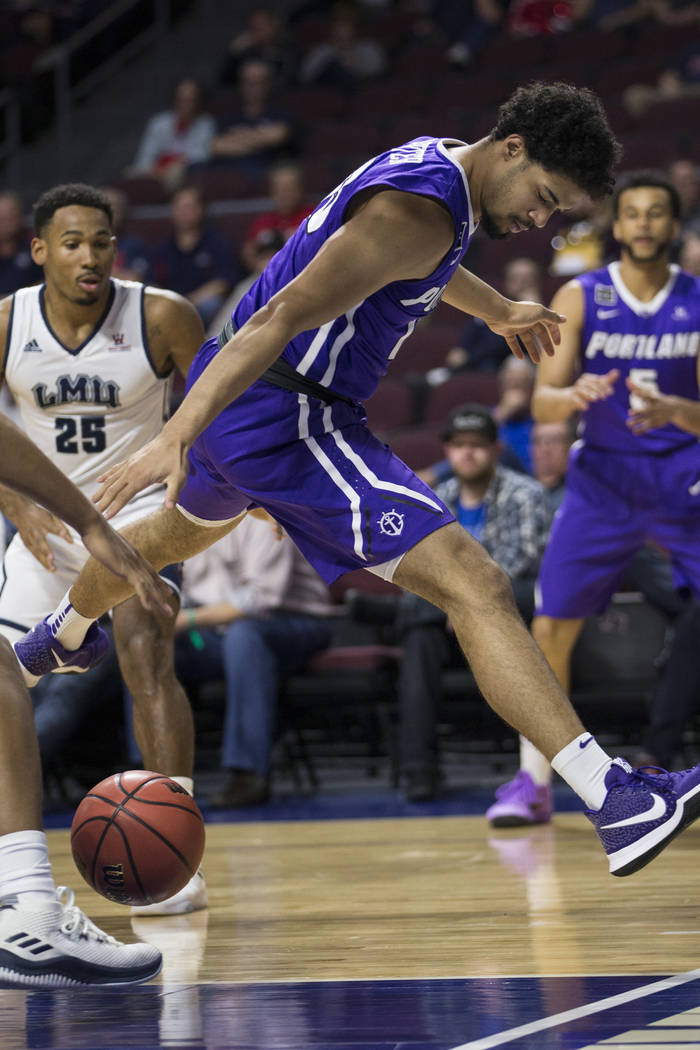Portland Pilots guard Franklin Porter (13) loses the ball against Loyola Marymount Lionsin the first half ofthe West Coast Conference Men's Basketball Tournament game at the Orleans Ar ...