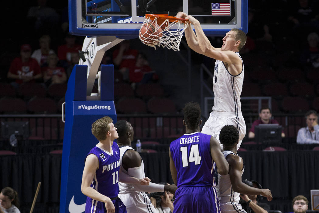 Loyola Marymount Lions center Mattias Markusson (14) dunks the ball against Portland Pilotsin the first half ofthe West Coast Conference Men's Basketball Tournament game at the Orleans ...