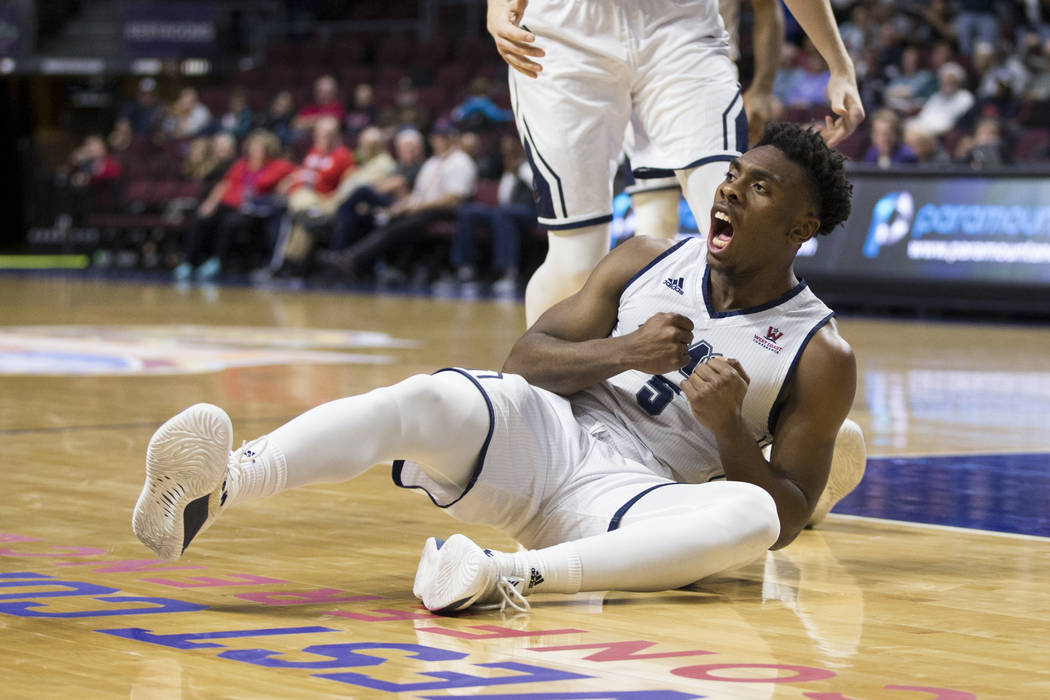 Loyola Marymount Lions guard James Batemon (5) reacts after scoring a basket against Portland Pilots in the second half of the West Coast Conference Men's Basketball Tournament game at the Orleans ...