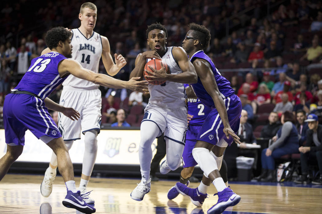 Loyola Marymount Lions guard James Batemon (5) drives the ball to the basket against the Portland Pilots in the second half of the West Coast Conference Men's Basketball Tournament game at the Orl ...
