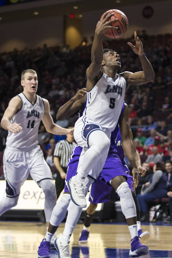 Loyola Marymount Lions guard James Batemon (5) goes up for a layup against Portland Pilots in the second half of the West Coast Conference Men's Basketball Tournament game at the Orleans Arena in  ...