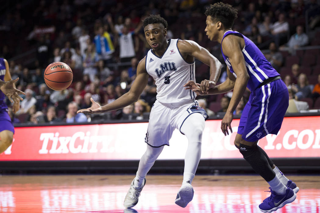 Loyola Marymount Lions guard James Batemon (5) makes a pass against Portland Pilots in the second half of the West Coast Conference Men's Basketball Tournament game at the Orleans Arena in Las Veg ...