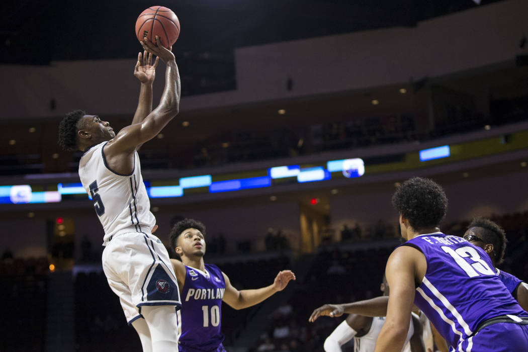 Loyola Marymount Lions guard James Batemon (5) takes a shot against Portland Pilots in the second half of the West Coast Conference Men's Basketball Tournament game at the Orleans Arena in Las Veg ...