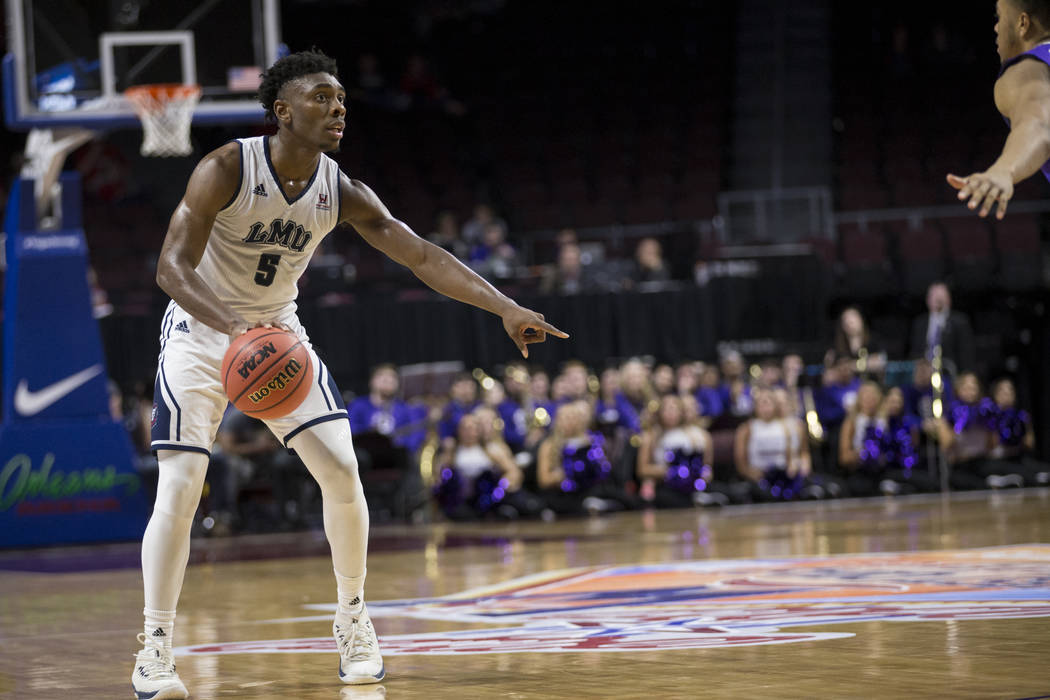 Loyola Marymount Lions guard James Batemon (5) looks for an open pass against Portland Pilots in the second half of the West Coast Conference Men's Basketball Tournament game at the Orleans Arena  ...