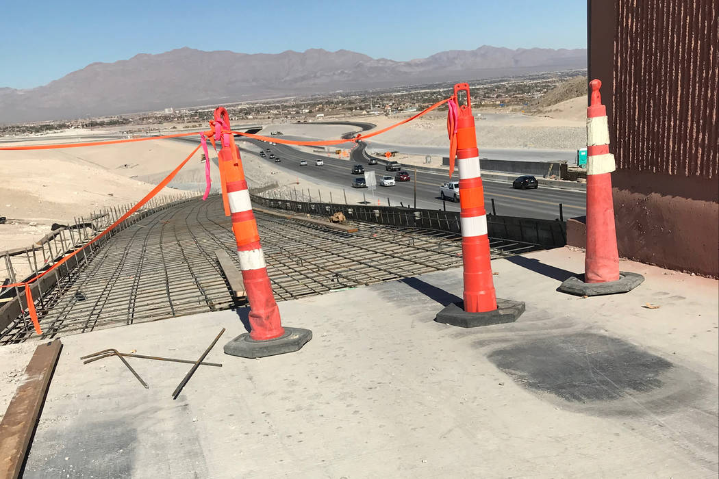 Before concrete was poured late last month, a section of the Western Beltway Trail is closed where it descends northward toward Lone Mountain Road on Saturday, Feb. 17, 2018. The trail is now open ...