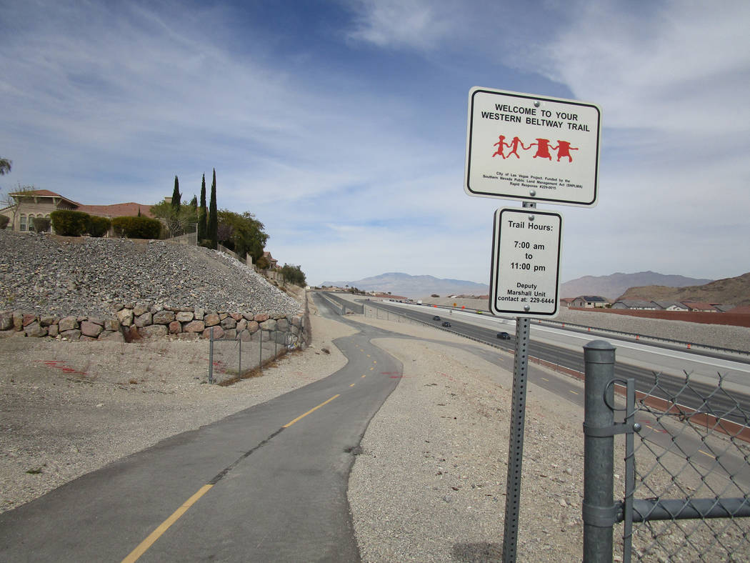 A sign marks the Western Beltway Trail looking north from a crossing at West Alexander Road in northwest Las Vegas on Thursday, March 8, 2018. The pedestrian and bike trail is now open between Ale ...