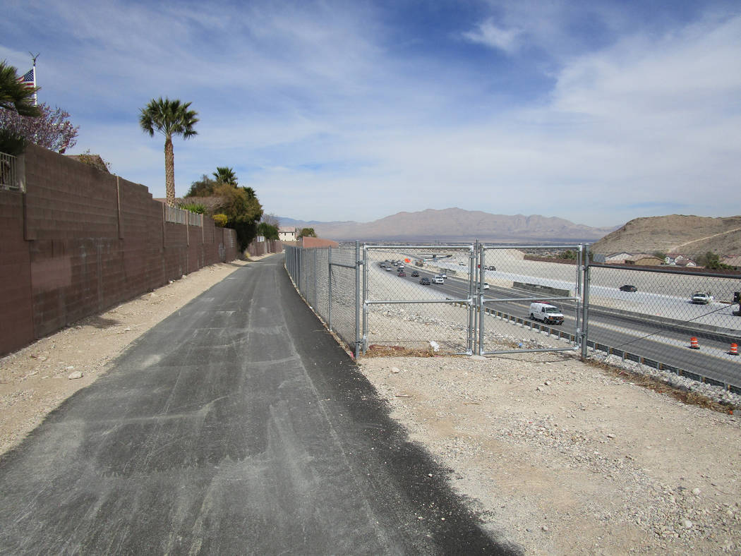 The Western Beltway Trail is now open between Alexander Road and Centennial Parkway. The new section of the trail is shown near its highest point just west of Lone Mountain in northwest Las Vegas  ...